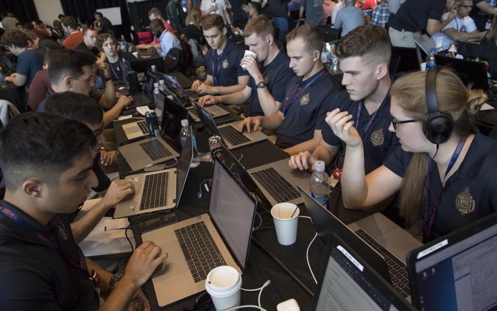 NEW YORK (Sept. 7, 2019) A team of Naval Midshipmen and Air Force Airmen from the Naval Academy and Air Force Academy participate in track one during HacktheMachine competition at the Brooklyn Navy Yard in New York City, Sept. 7, 2019.
