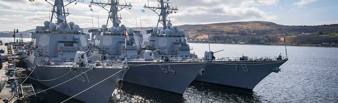 The Arleigh Burke-class guided-missile destroyers USS Gravely (DDG 107), USS Carney (DDG 64), and USS Porter (DDG 78) are moored at HMNB Clyde in Faslane, Scotland