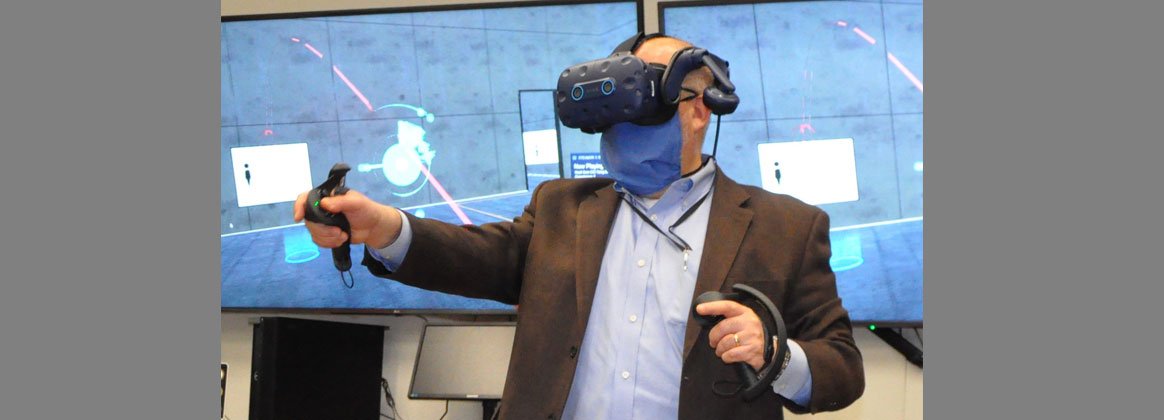 NSWCDD Technical Director John Fiore interacts with a concept captured in virtual reality.