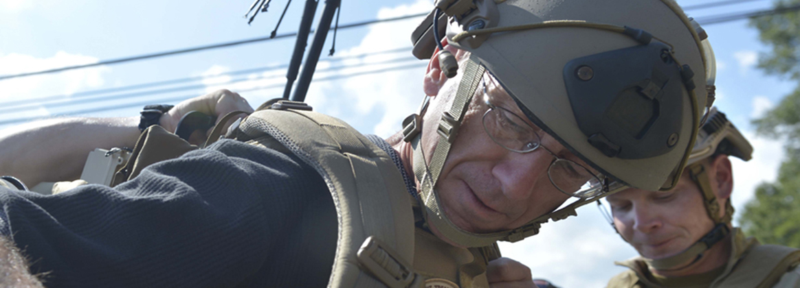 Assistant Secretary of the Navy for Research, Development and Acquisition Sean Stackley dons protective gear for an EOD