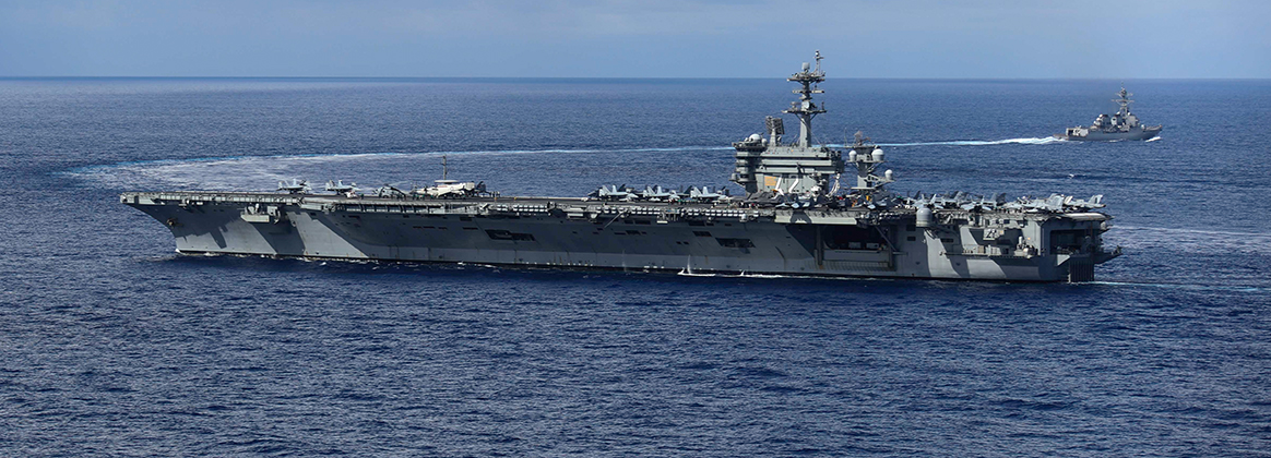 USS Mason (DDG 87), top, pulls away from the Nimitz-class aircraft carrier USS Abraham Lincoln (CVN 72)