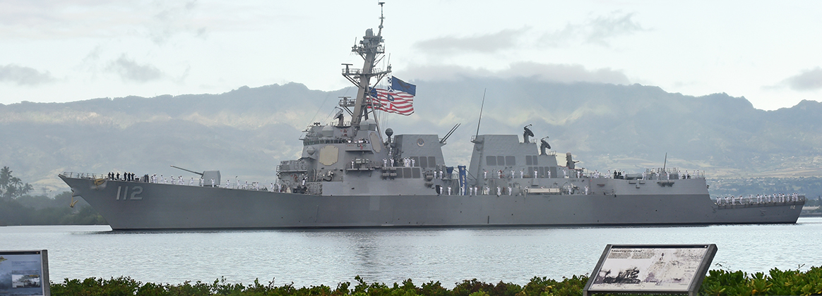 USS Michael Murphy (DDG112) renders honors during the National Pearl Harbor Remembrance Day 77th Anniversary Commemoration.
