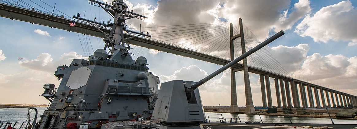 USS Jason Dunham (DDG 109) passes under Peace Bridge during the ship's transit of the Suez Canal.