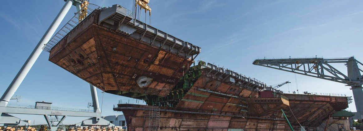 NEWPORT NEWS, Va. (July 10, 2019) The final piece of the flight deck of the future USS John F. Kennedy (CVN 79) is lifted into place at Huntington Ingalls Industries' Newport News Shipbuilding Division in Newport News, Va., July 10.