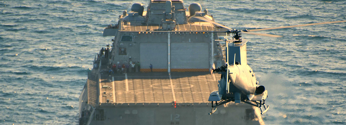 MQ-8B Fire Scout unmanned helicopter approaches littoral combat ship USS Omaha (LCS 12)