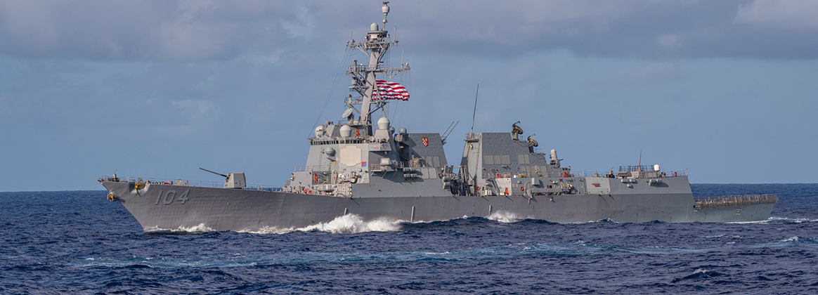 The Arleigh Burke-class guided-missile destroyer USS Sterett (DDG 104) is underway in formation during dual carrier operations with the Nimitz and Theodore Roosevelt Carrier Strike Groups (CSG).