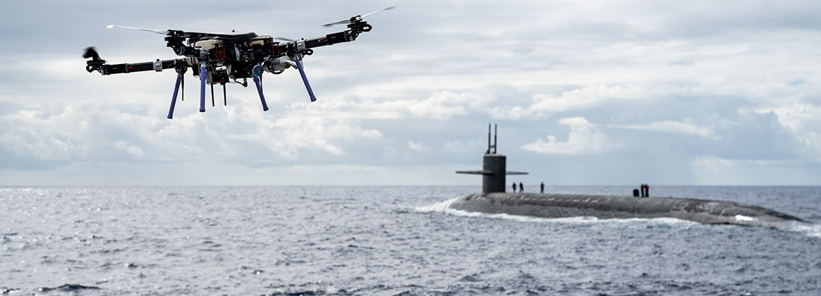 n unmanned aerial vehicle delivers a payload to the Ohio-class ballistic-missile submarine USS Henry M. Jackson (SSBN 730)