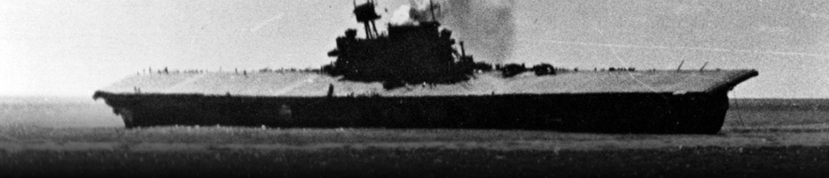 Image: USS Yorktown (CV-5) dead in the water and listing heavily, shortly after being hit by two Japanese Type 91 aerial torpedoes