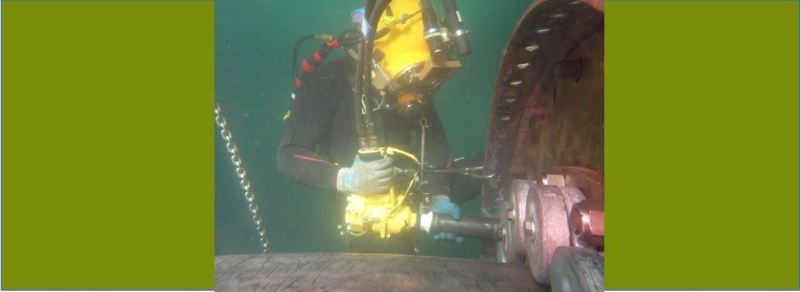 SUPSALV diver repairing USS Preble bearing