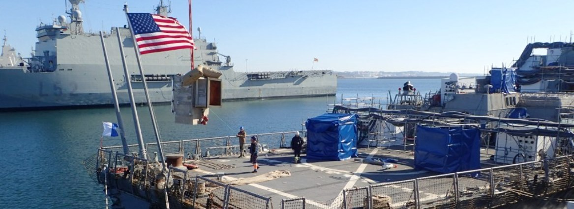 Habitat being lowered into the water to support repairs to USS CARNEY