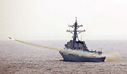 The guided-missile destroyer USS McCampbell (DDG 85) fires a drone during a test of the air defense systems of the aircraft carrier USS George Washington (CVN 73). George Washington is underway in the western Pacific Ocean from its permanently forward-deployed port at Commander, Fleet Activities Yokosuka for a combat operations efficiency evaluation. (U.S. Navy photo by Mass Communication Specialist 3rd Class Jared M. Hill/Released)