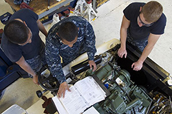Sailors assigned to the aircraft intermediate maintenance department aboard USS Essex (LHD 2) rebuild a tow tractor as part of an overhaul of their gear during the ship's maintenance and dry-dock period. The tractor was completely disassembled, stripped down to bare metal to remove corrosion and damage and then repainted before being reassembled. (U.S. Navy photo by Senior Chief Mass Communication Specialist Joe Kane/RELEASED)