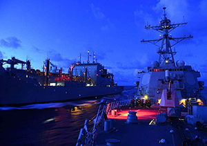 The Arleigh Burke-class guided-missile destroyer USS Lassen (DDG 82), right, receives fuel from the Military Sealift Command dry cargo and ammunition ship USNS Amelia Earhart (T-AKE 6) during an underway replenishment. Lassen is on patrol in the U.S. 7th Fleet area of responsibility in support of security and stability in the Indo-Asia-Pacific region. (U.S. Navy photo by Mass Communication Specialist 2nd Class Corey T. Jones/Released)