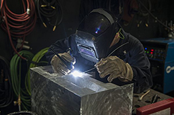 Hull Maintenance Technician 2nd Class A. Lightfoot welds a shelf in the repair shop aboard the aircraft carrier USS Harry S. Truman (CVN 75). The Harry S. Truman Carrier Strike Group is underway conducting training in preparation for a future deployment. (U.S. Navy photo by Mass Communication Specialist Seaman B. Siens/Released)