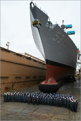 (Sept. 7, 2010) Sailors assigned to the guided-missile destroyer USS John Paul Jones (DDG 53) stand in front of the ship during its last day in dry dock.